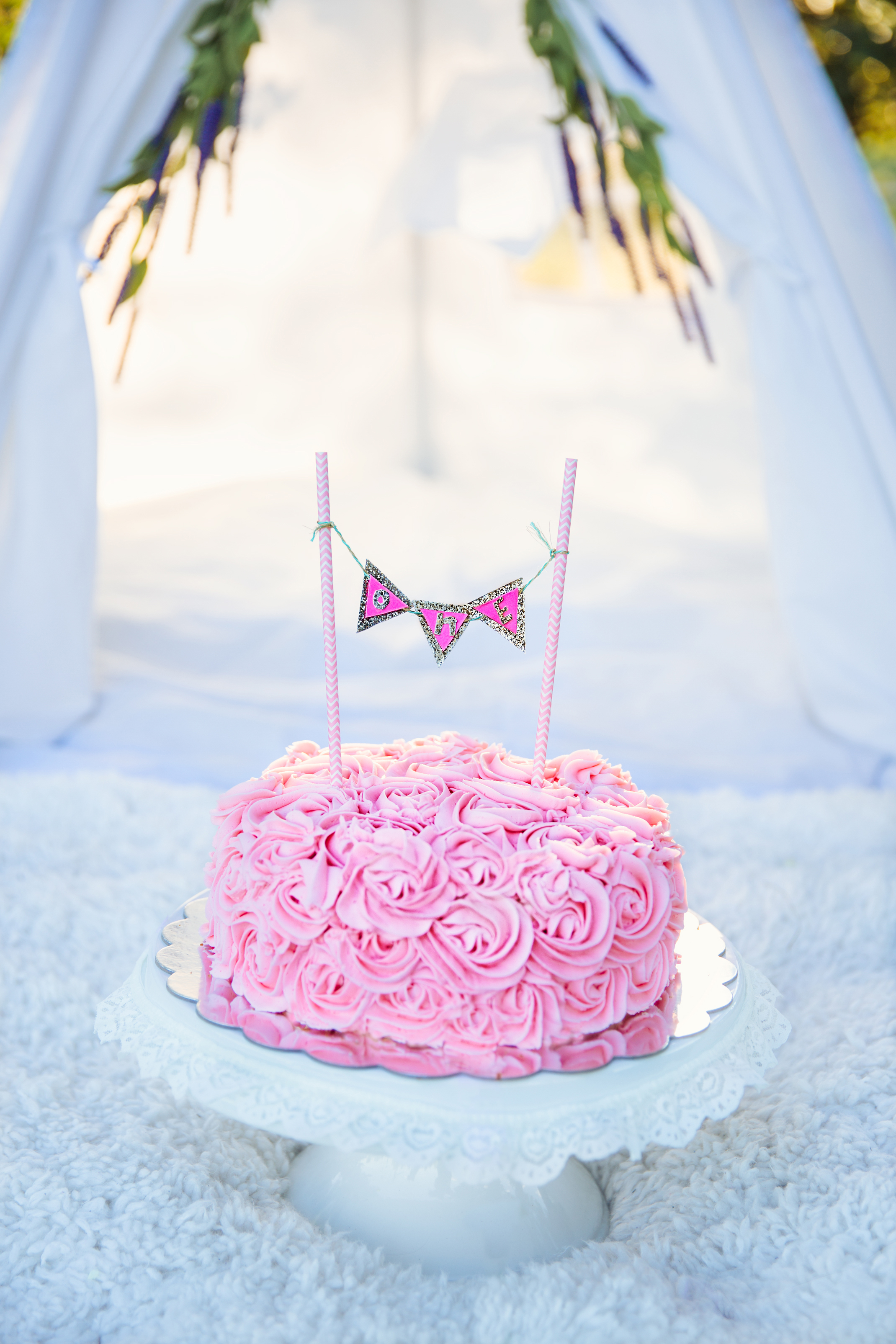 piped roses on cake with DIY cake topper