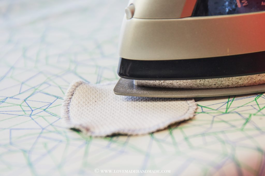 Ironing the cotton rounds to get them nice and flat! - LOVEMADE HANDMADE