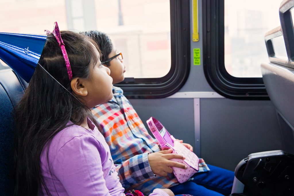 Kids riding on the bus to go to their dad's NYC office for Take Your Sons and Daughters to Work Day